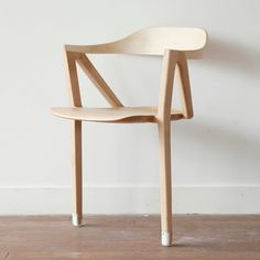 Chair with two legs designed to encourage physical activity.