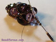 Filled net tutorial-also beaded beads, embellished beaded beads!! Great website!