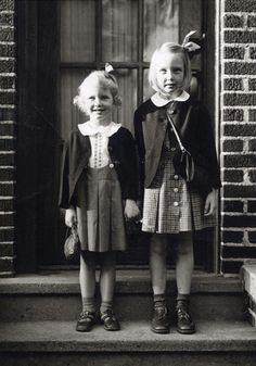 Lois Lowry, age five, and her elder sister, on the first day of kindergarten and second grade, respectively, 1942. Photo via Teaching Books.