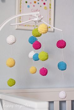 Crocheted balls make up this colorful crib mobile.