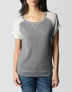 Sporty meets chic in a heavenly soft raglan top. Luxe cashmere and silk sleeves add a feminine touch to this vintage, sweatshirt for the perfect...