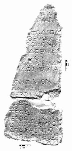 A fragment of one of the inscriptions that recorded the sale of property confiscated from those found guilty in the scandals of 415 B.C.