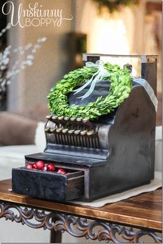 """Vintage cash register filled with ornaments and set to """"25"""" cents. Cute boxwood wreath, too!"""