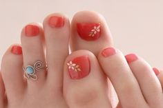 Love the polish and the toe ring.  Orange floral pedicure wearing a turquoise and silver toe ring.
