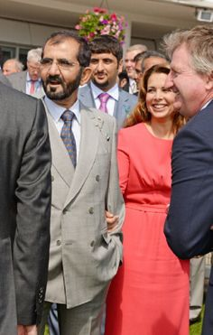 Sheikh Mohammed bin Rashid Al Maktoum (L) and Princess Haya bint Al Hussein attend Ladies Day at the Investec Derby Festival at Epsom Downs Racecourse, 06.06.2014 in Epsom, England.