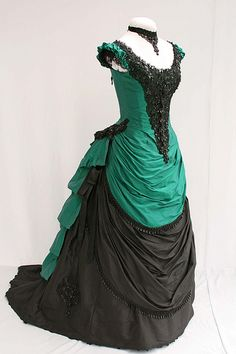 Gorgeous reproduction of a green and black 1870s evening gown.