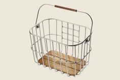 for the gal who lives where it doesn't rain all the time.  love this metal basket.   Brooks Hoxton Wire Basket MED  http://www.adelineadeline.com/catalog/product/view/id/151/category/5/