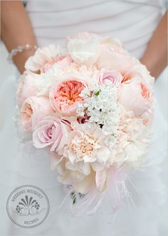 """10 stems Juliet Garden Roses  7 stems Sweet Avalanche roses  8 stems white fringed tulips  5 stems """"Libretto"""" parrot tulips  10 stems """"Lizzy"""" peach carnations  10 stems Allium Neopolitanum  2 light pink Maribou poufs --- cool!"""