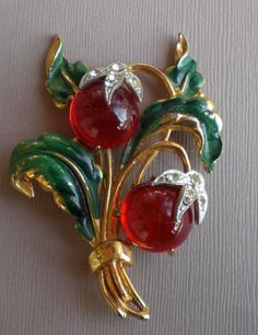 A beautiful c. 1940s painted metal, glass, rhinestone fruit (they look like cherries to me) brooch. #vintage #1940s #brooches #jewelry