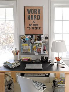 desk + inspiration board between two windows