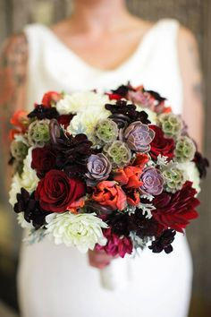 A lovely fall wedding bouquet with succulents. McCalls Catering and Events.
