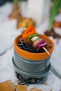 Make a mini grill...great for parties.  one small terracotta planter, wire mesh and two miniature adjustable cake pans.  There really is no tutorial and no detailed photos, so I will have to figure it out on my own and then post.  How great would this be after a backyard bbq with roasted marshmallows.  Each kid gets his own!