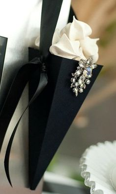 small, elegant black square cone w/ vintage rhinestone pin filled with vanilla swirl chocolate drops - so elegant