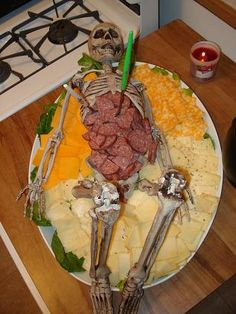 Corpse Buffet for a Haunted Hospital Theme,  except life-sized so it makes sense. corps buffet, halloween parties, halloween party foods, halloween party ideas, cheese trays, halloween foods, skeleton, haunt hospit, cheese platters