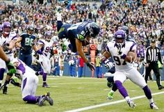Seahawks receiver Golden Tate dives for the end zone against the Minnesota defense late in the first half, scoring the go-ahead touchdown on an 11-yard reception. Seattle won, 30-20. (Photo by John Lok / The Seattle Times)