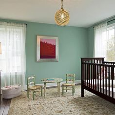 Mix a solid wood crib with a bright metallic light fixture for a simply elegant #nursery.