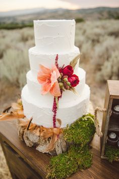 White wedding cake garnished with fall flowers