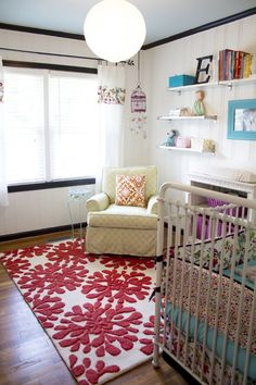 This pink and white @Anthropologie rug adds such a beautiful pop of #pink! #nursery #rug