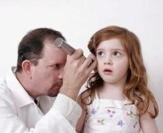Another view of your doctor looking at your ear with an otoscope (that special light thingy)