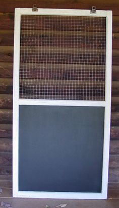 Used an old screen window frame, added chicken wire to the top and a magnetic blackboard to the bottom.