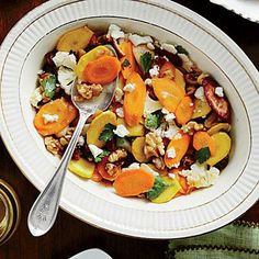 Carrot-Cauliflower Salad | We created this crunchy, sweet side as an update of the classic mayonnaise-laden carrot-and-raisin salad. Save time and make it ahead—it eats even better the next day. | SouthernLiving.com