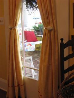 Sweet yellow checked curtains with a bit of red (from Dear Daisy Cottage)