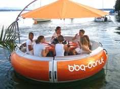 the bbq donut. a party boat, shaped like a donut, made for grilling. literally perfect.