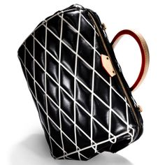 Louis Vuitton debuts the Doc bag. Click here for more.