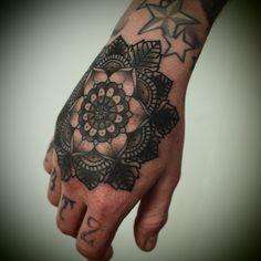 Geometric Flower Hand Tattoo