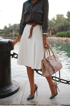 She's a lady: Flowing white skirt paired with a refined blouse and matching pumps. tucked silk blouse bodysuit.
