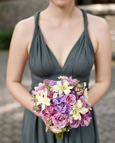 This bouquet of roses, snapdragons, and hydrangeas pops against this charcoal bridesmaid dress