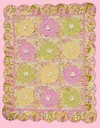 HONEY PIE just says little girl.  The Rag-edged three dimensional flowers add an extra softness to the fabrics. The beautiful scalloped border completes the soft look. http://www.kayewood.com/item/Honey_Pie_Quilt_Pattern/2783 $9.00