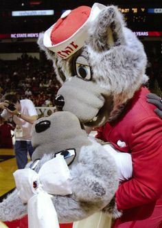 Mr. Wuf sneaks in for a romantic dancing dip with Mrs. Wuf during a basketball game. (2010)