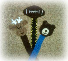 Paci clips with deer applique, football applique, and a bear applique