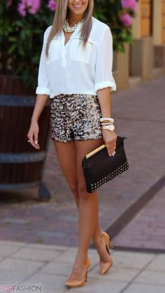 White top with print shorts, nude heels and gold accessories.