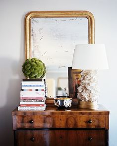 Aged mirror and stacked books