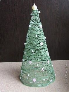 christmas tree: cover cone with saran wrap, wrap with yarn, slather with glue, let dry, remove cone... viola!