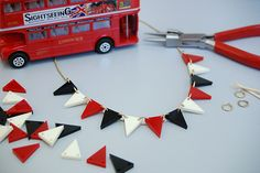 Have you heard the news? We're taking over our very own classic London bus and hosting Bunting Necklace Workshops! Join in the fun and book your place now: http://tattydevine.com/blog/2014/06/hop-on-board-the-tatty-devine-bus/