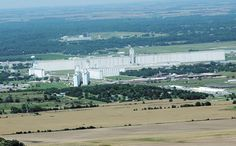 The Farmers Co-Op Commission elevator. World's largest grain elevator, located in Hutchinson, Kansas. Built in 1961, with a capacity of over 17 million bushels, it exceeds 1/2 mile in length.