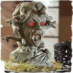 Medusa Animated Halloween Bust ~ When the motion sensor is activated, snakes begin to move and hiss and Medusa's eyes and mouth glow red as she speaks three different sayings.