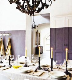 Paints & Palettes: Half-Painted Walls in Bold Colors : Remodelista (fun vertical purple stripe down the wall in the background, accented with a gold frame) dining rooms, the doors, painted rooms, paint palettes, painted doors, decorate home, bold colors, decor blogs, painted walls