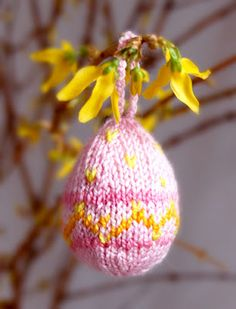 Perfect for using up scrap yarn, these hanging egg cozies make for great DIY Easter decorations.
