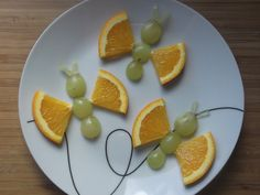 Fun snack art - butterflies with grapes and oranges!