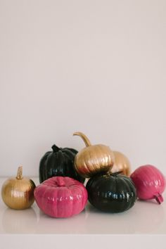 High Gloss Pumpkins  #gold, #halloween, #pumpkin, #pink, #black  Photography: Ruth Eileen Photography - rutheileenphotography.com  View entire slideshow: Decorating for a Chic Halloween on http://www.stylemepretty.com/collection/729/