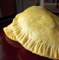 Lamb Empanadas 1 lb ground lamb 1 small onion, chopped finely 1 medium tomato, chopped 2 cloves garlic, minced 1 tbsp butter 1/2 tsp allspice 1/2 tsp cayenne pepper 1/2 tsp black pepper 1 tbsp coriander 1/2 cup water 1 sprig rosemary, bruised with the back of a knife 2 scallion, finely chopped 1 egg yolk 1 tsp water 1 Pastry recipe, provided below