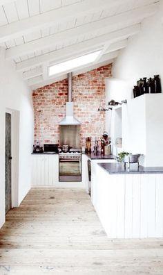 White kitchen and exposed brick