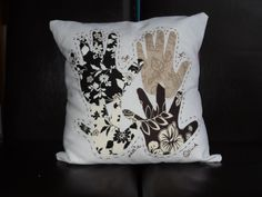 I love this idea... childs handprints on fabric then sew 'em onto a pillow :) I'll have to do this (IE. Get my mom to sew them on... I can't sew for poo!)