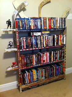 Hockey stick DVD / book rack..this would go right along with the hockey stick chair and coat rack we made.