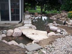 flagstone path across pond