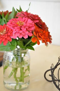 Use recycled jam and pickled jars fro vases....green crafting